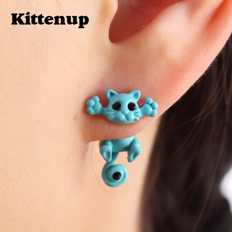 light blue kitty earrings in a woman or girl's ear