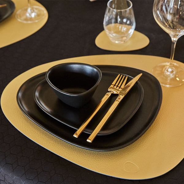 hippo gold leather placemat