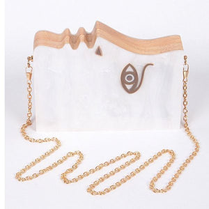 HELEN OF TROY CLUTCH