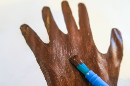 Paint hand brown