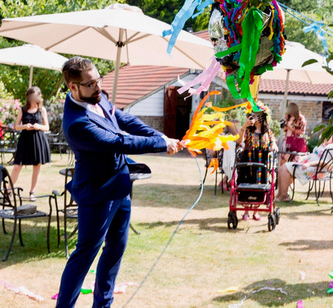 Ben hitting wedding pinata