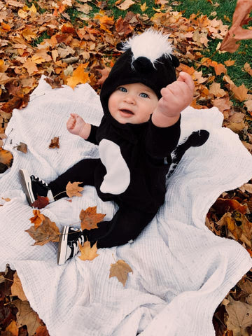 baby dressed as a skunk for halloween using kyte baby onesie in Midnight