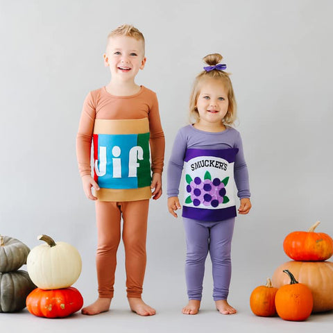 toddlers dressed in kyte baby toddler pajamas as peanut butter and jelly for halloween