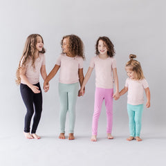 Four girls playing featuring Kytes leggings in midnight, sage, bubblegum and jade