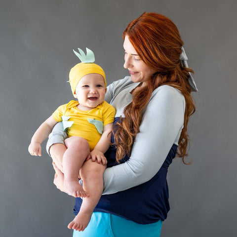 mom and baby dressed up as ariel and flounder from the little mermaid using kyte baby pieces