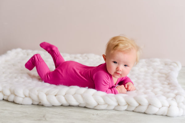 baby doing tummy time wearing kyte baby onesie