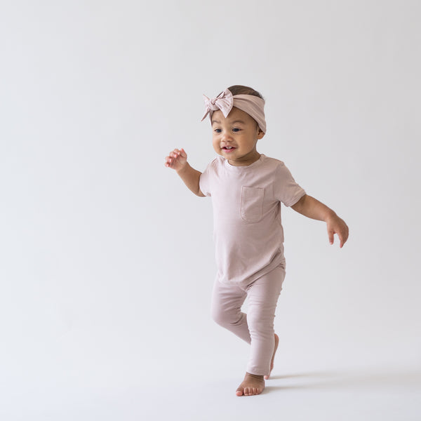 toddler dressed in sunset color and walking