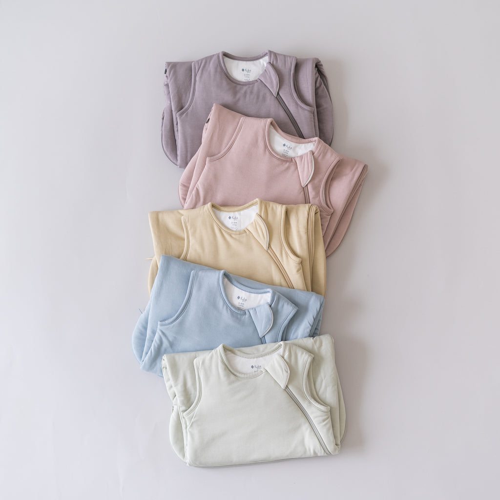 5 Colors of Sleep Bags folded and laid down