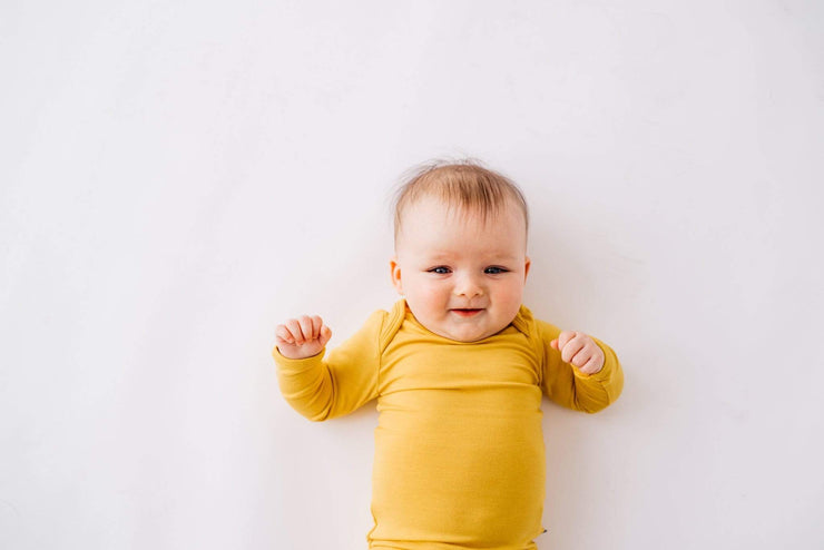 Long Sleeve Bodysuit in Mustard - Kyte Baby