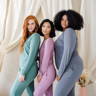 Three women modeling Jogger Pajama Sets in Pine, Mulberry and Charcoal