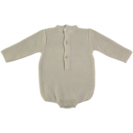 Classic style baby grow in cream colour with small pompom. Made in Spain.