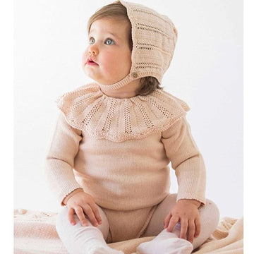 Pale pink romper suit with ruffle collar