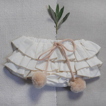 Baby bloomers with pom-poms