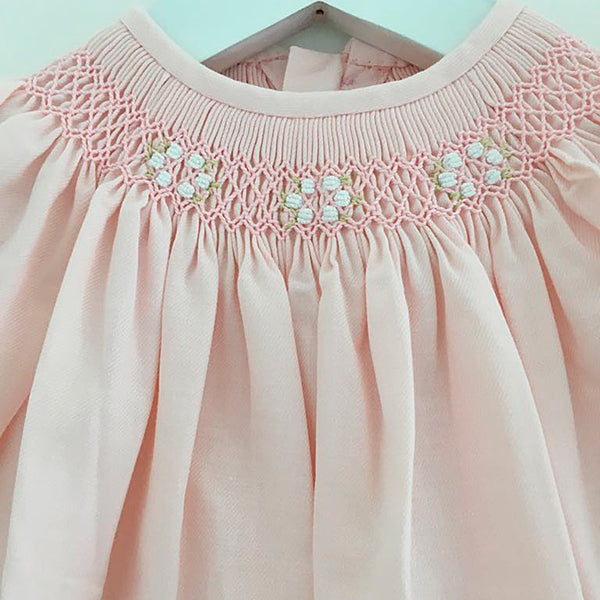 Soft pink hand smocked girls dress