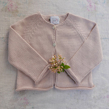 Pink baby cardigan with pompoms