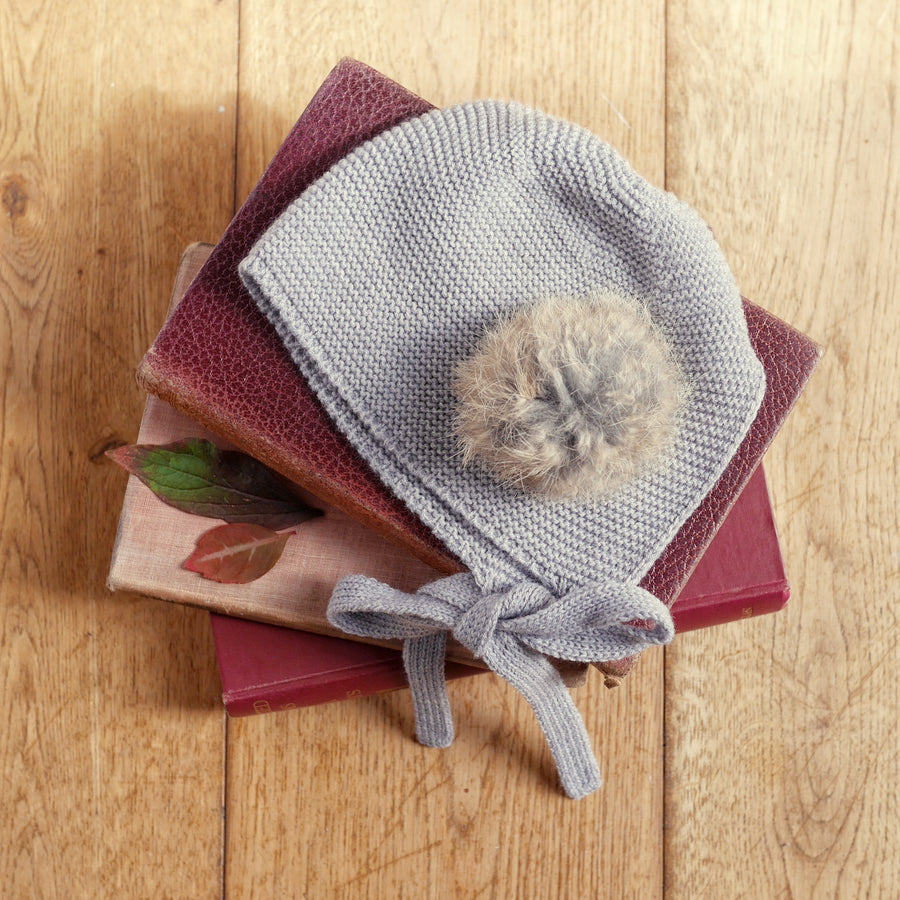 grey pompom bonnet