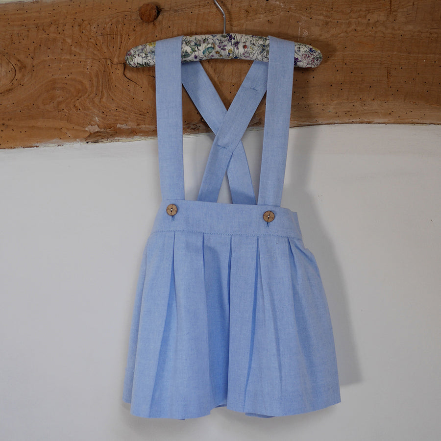 Blue girls skirt with braces