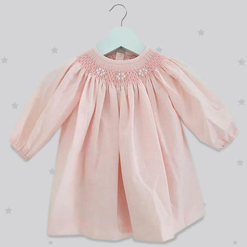 Soft pink handsmocked girls dress