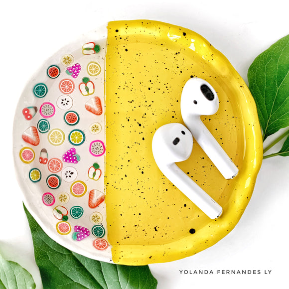 ring dish with fruit airpod holder