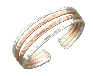 Sterling Silver and 12 Karat Rose Gold Filled Hammered Four Band Ring