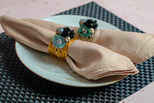 Load image into Gallery viewer, Ornate Flora Napkin Rings - Gold Plated Black & Blue Hue