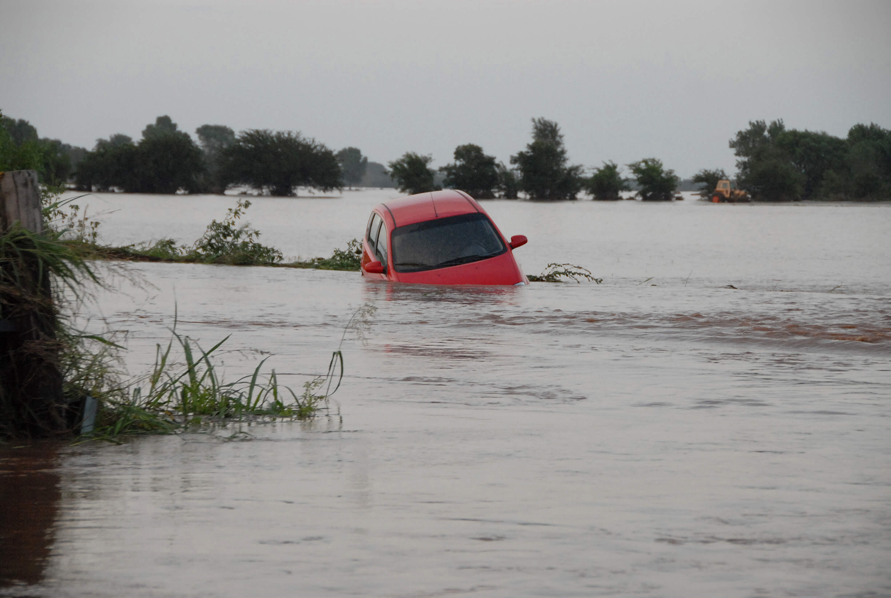 Red Car Floating In Flood Waters In Oklahoma