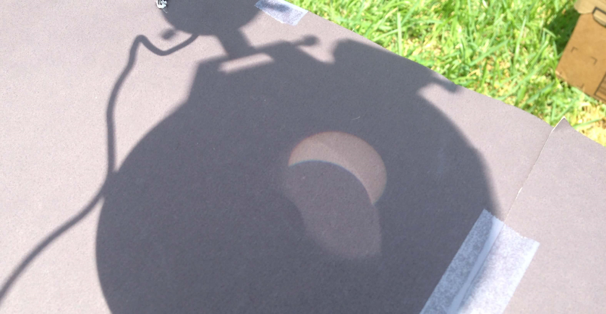 Image of Solar Eclipse through telescope on cardboard