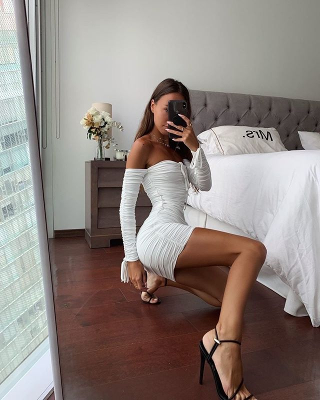 white long sleeve ruched off the shoulder dress