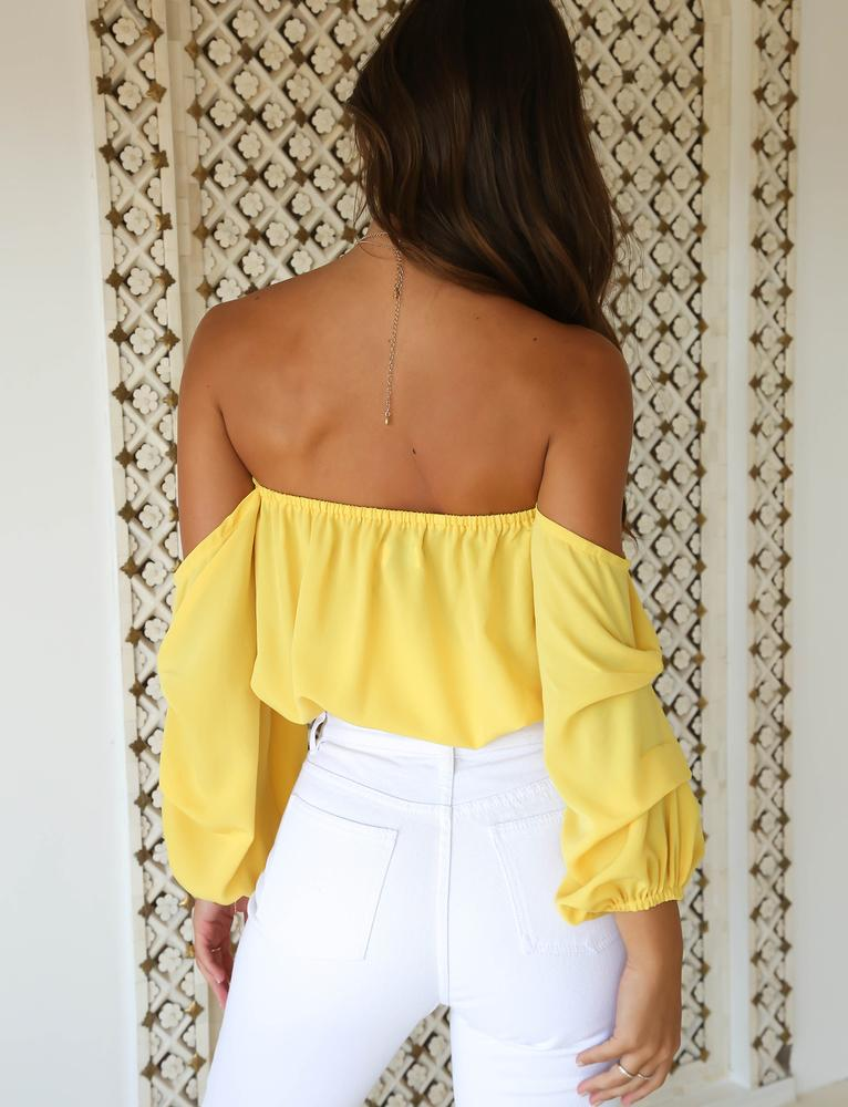 yellow off shoulder draped top