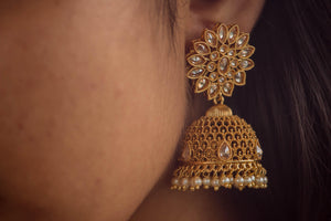 CZ Stones Studded Antique Gold Floral Jhumkas - White