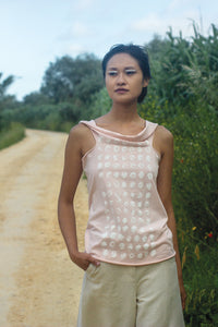 Elementum multifunctional seashell pink top with silkscreen print dots in white.