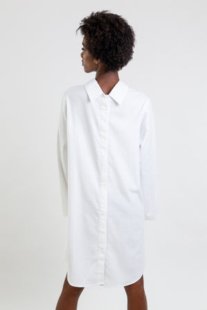 Multifunctional white shirt which can be worn as a long shirt, dress or tunic.
