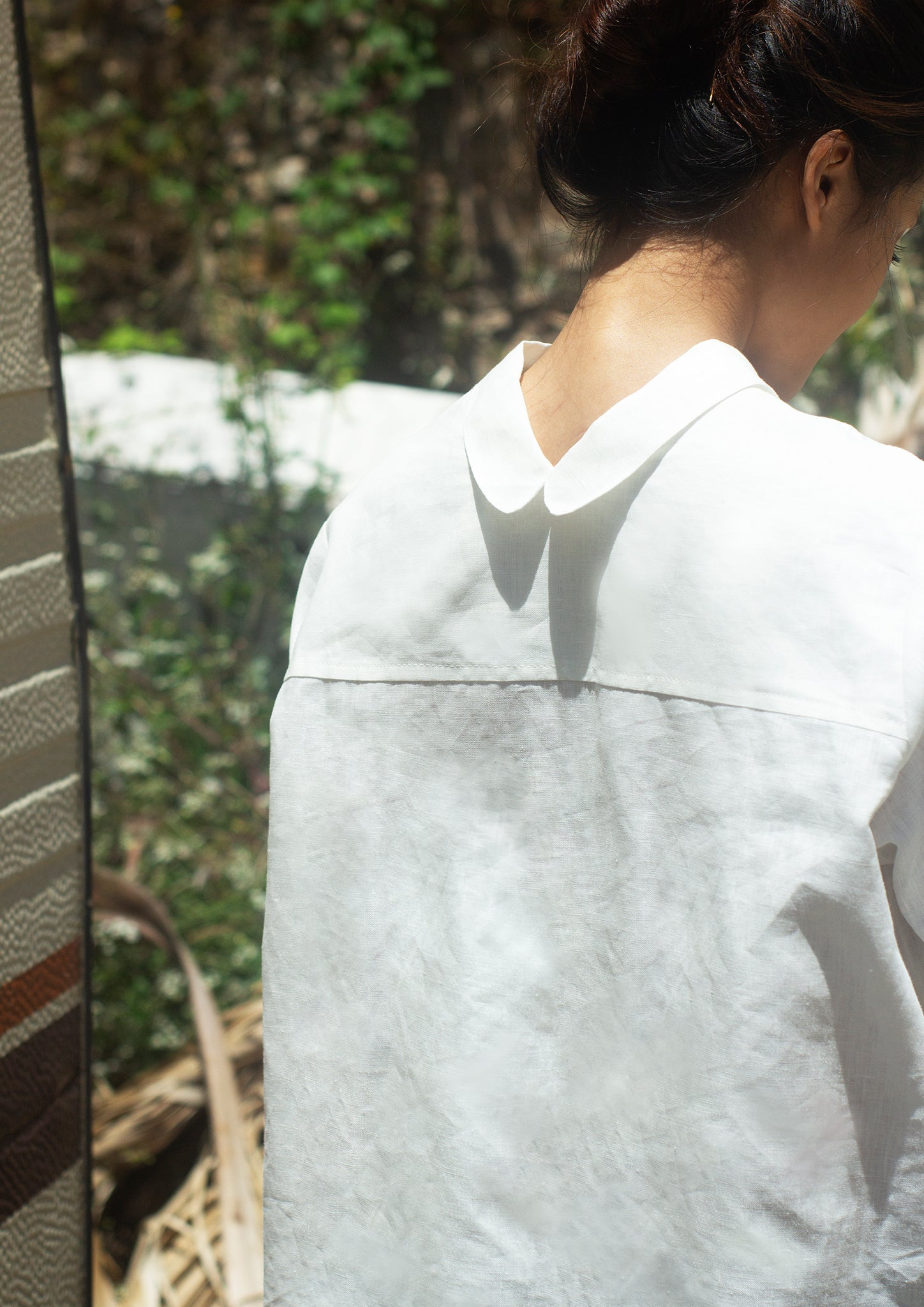 woman wearing Elementum multifunctional linen shirt