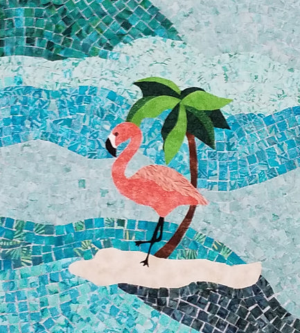 Pink flamingo standing on a tiny island surrounded by tiny fabric blue tiles.  Flamingo Island quilt pattern by Jackie Vujcich coming soon to Colorado Creations Quilting