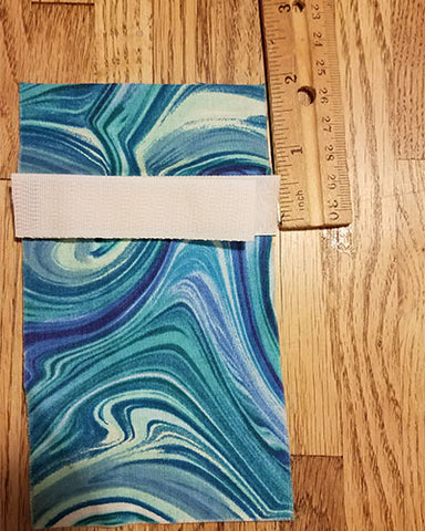 "Image shows a ruler next to edge of fabric about 2"" down from top.  velcro is placed at this 2"" mark"