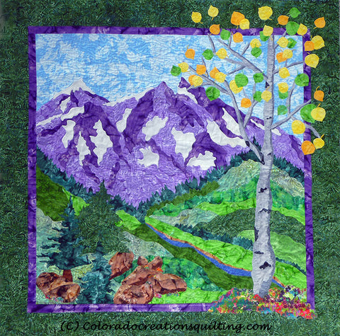 Pictorial landscape art quilt featuring purple snow-capped mountains with a blue stream, evergreens, boulders and aspen trees by Colorado Creations Quilting