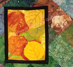 Snapshots of Colorado quilt by Jackie Vujcich features image of aspen leaves