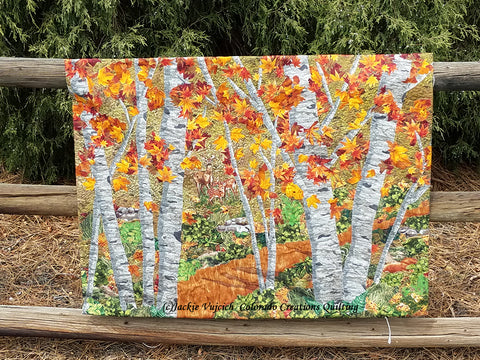 Art Quilt picturing a group of aspen trees in the woods by Colorado Creations Quilting