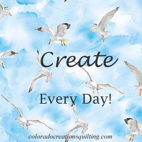 """Image shows seagulls flying in a light blue sky with the words """"Create Every Day"""""""