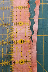a scalloped edge cut off of binding strip