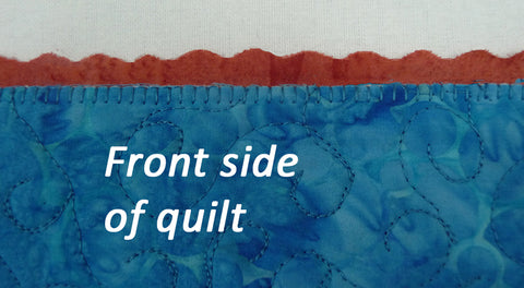 blanket stitching shown on the curved edge binding