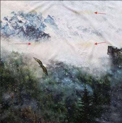 Fabric features eagles flying over the mountain tops.
