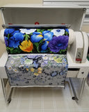 Image of fabric coming out of the Mangle ironing machine by Colorado Creations Quilting