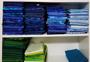 Organized and folded blue fabric