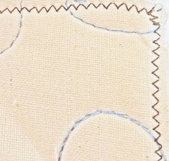 zigzag stitch secures 3 layers of a quilt