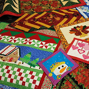 Christmas quilts designed and made by Jackie Vujcich of Colorado Creations Quilting