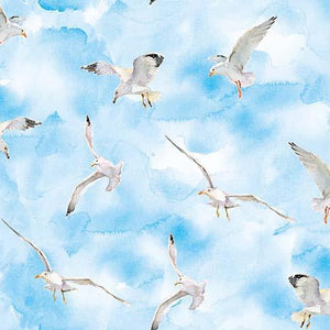 This cotton fabric features watercolored seagulls on a rich blue background. Available at Colorado Creations Quilting