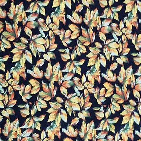 Fall Leaves of green, orange, and yellow on a black background cotton fabric available at Colorado Creations Quilting