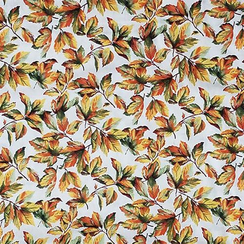 Fall Leaves of green, orange, and yellow on a cream background cotton fabric available at Colorado Creations Quilting