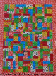Quick Quart Quilt  is a mix-and-match of squares and rectangles with a surrounding border available at Colorado Creations Quilting